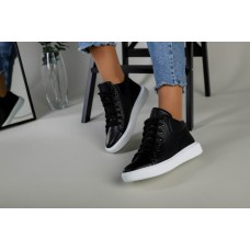 Женские черные кожаные кеды на шнурках